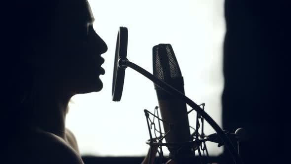 Thumbnail for Silhouette Woman is Singing a Song