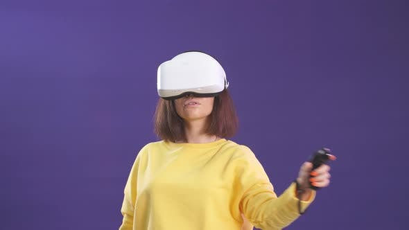 Thumbnail for Virtual Reality Game. Girl with Pleasure Uses Head-mounted Display