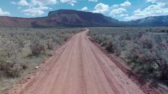 Thumbnail for Aerial drone view of a 4x4 off-road dirt road near Moab, Utah.