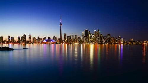 An epic view of a day to night timelapse of Toronto city