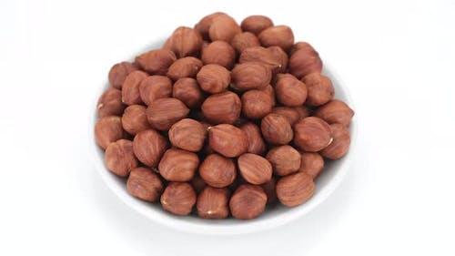 hazelnuts isolated on white background, rotation