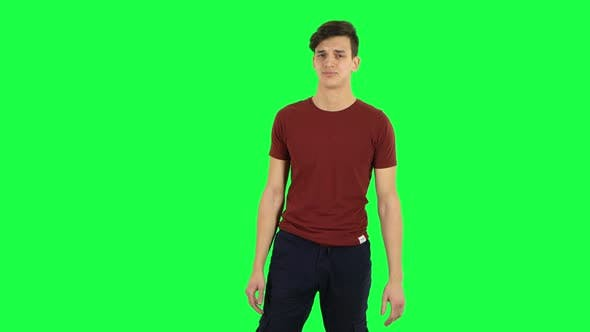 Cover Image for Guy Strictly Gesturing with Hands Crossed Making X Shape Meaning Denial Saying NO. Green Screen