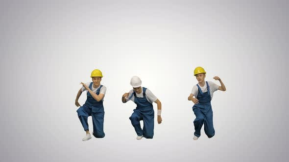 Thumbnail for Three Young Construction Workers in Hard Hats Synch Dancing Looking at Camera on Gradient Background