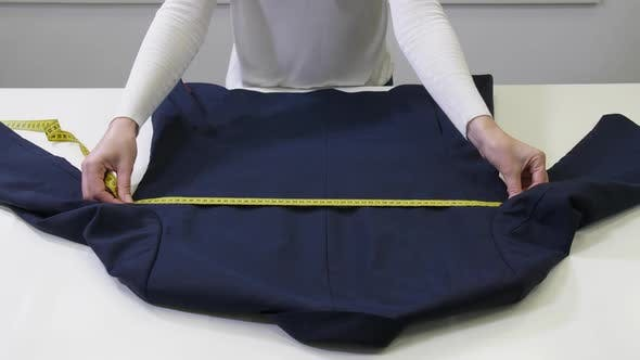 Thumbnail for Hands of Dry-cleaning Worker Measuring Clothes