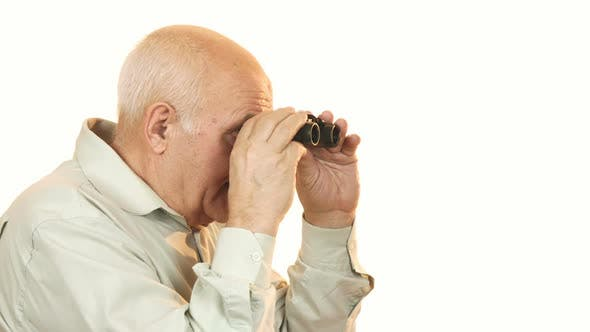 Thumbnail for Happy Grandfather Smiling To the Camera After Looking Away Using Binoculars