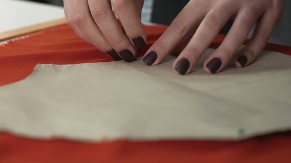 Thumbnail for Dressmaker Woman Attaching Pattern by Pins to Orange Fabric Tailoring Process