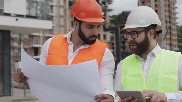 Thumbnail for Building a Residential Complex or Business Center Team of Engineers Men with a Tablet and Drawing
