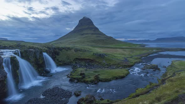 Kirkjufell Mountain and Kirkjufellsfoss Waterfall in Summer. Iceland