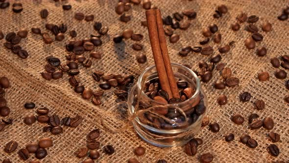 Thumbnail for Bottle with Coffee Beans and Cinnamon on Sacking