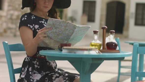Thumbnail for Beautiful Young Woman Got Lost in Resort City, Looking Confused, Checking Map