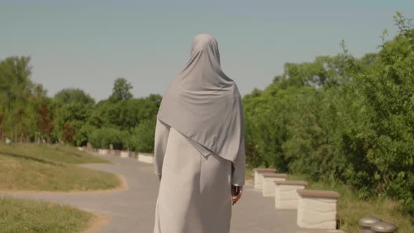 Thumbnail for Unrecognizable Muslim Woman Walking