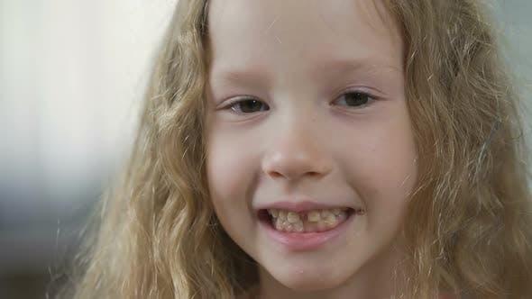 Funny Blond Child Showing Teeth Into Camera, Children's Orthodontics, Health