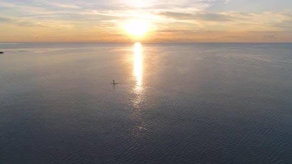 Thumbnail for Surfer Goes on a Solar Way at Sunrise