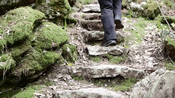 Thumbnail for Tourist on Steep Pilgrim Path Along Stone Steps