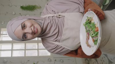 Beautiful Muslim Woman With Dish On Plate