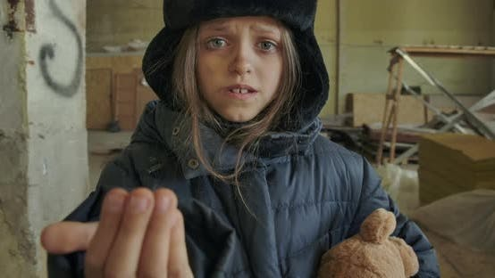Little Syrian Refugee in Dirty Winter Clothes Asking for a Handout