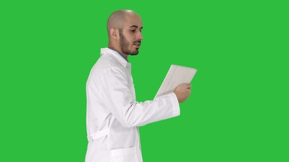 Cover Image for Sincere doctor making video call to his patient walking