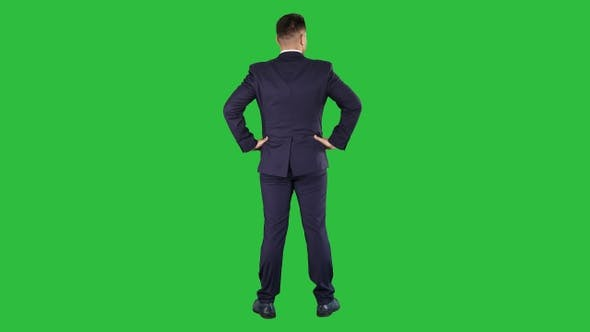 Thumbnail for Businessman looking around with hands on hips on a Green