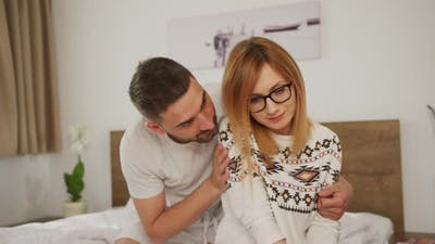 Husband comforting his wife