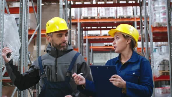 Thumbnail for Workers Talking and Walking through Warehouse