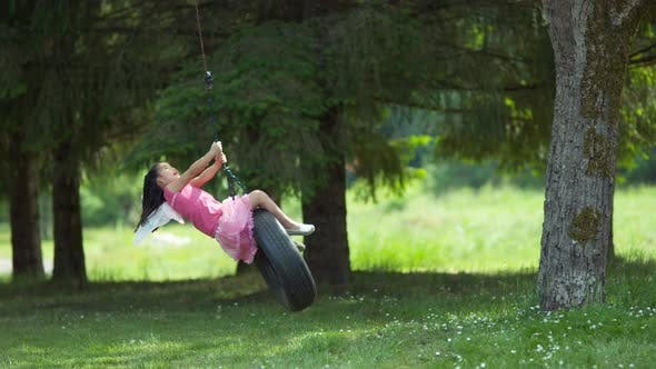 Thumbnail for Girl in fairy princess costume on tire swing, shot on Phantom Flex 4K