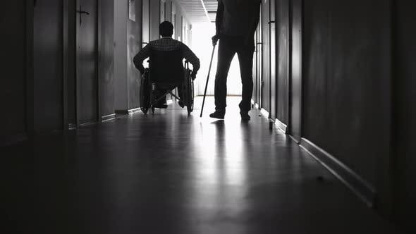 Thumbnail for Silhouettes of Disabled Patients in Hospital Corridor
