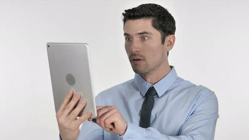 Businessman in Shock While Using Tablet