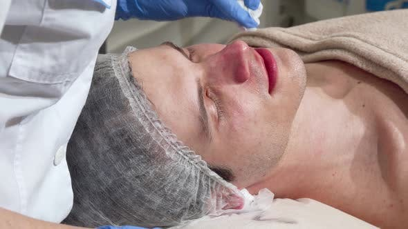 Thumbnail for Professional Cosmetologist Cleaning Skin of a Male Client with Cotton Pad