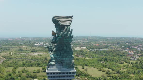 Side View of Huge Copper Statue in Bali Indonesia