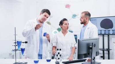 Group of Three Scientists in Modern Laboratory