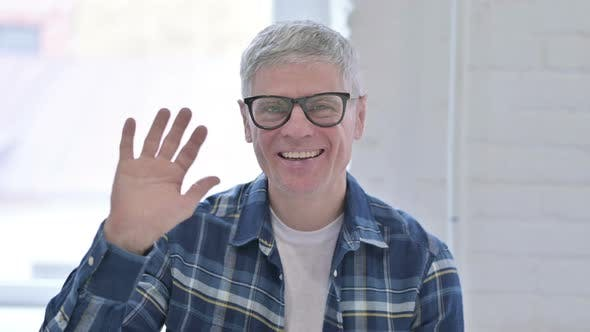 Thumbnail for Portrait of Attractive Casual Middle Aged Man Waving
