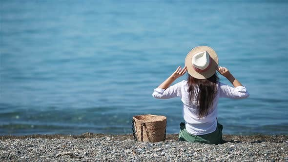 Thumbnail for Young Woman in Hat on the Beach Vacation