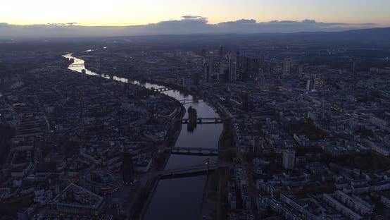 Thumbnail for Establishing Shot Above All of Frankfurt Am Main, Germany Skyline High in the Air at Dusk