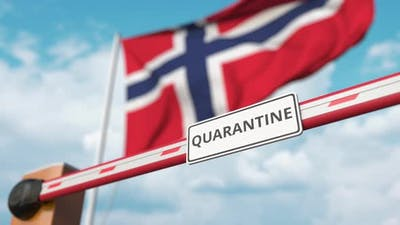 Barrier with QUARANTINE Sign Being Open at Flag of Norway