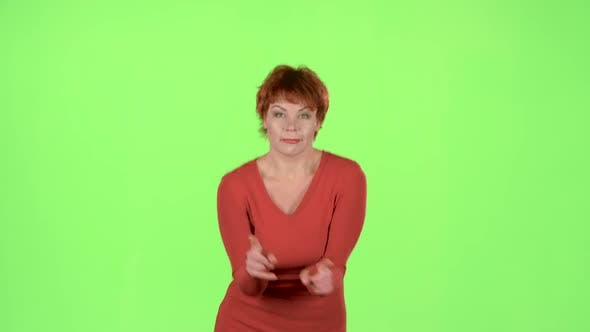 Thumbnail for Woman Is Dancing Energetically. Green Screen