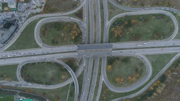 Aerial View Interchange Ring Road and Motorway Freeway Highways and Moving Cars Transportation in
