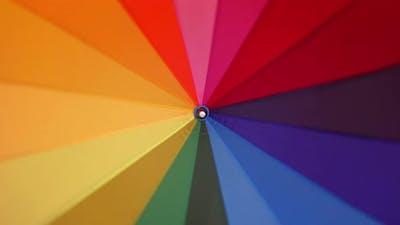 A Multi-colored Rainbow Umbrella Rotates