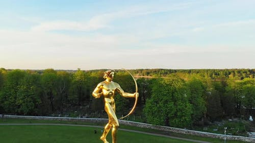 Spin Around Man With Bow Statue In Siauliai