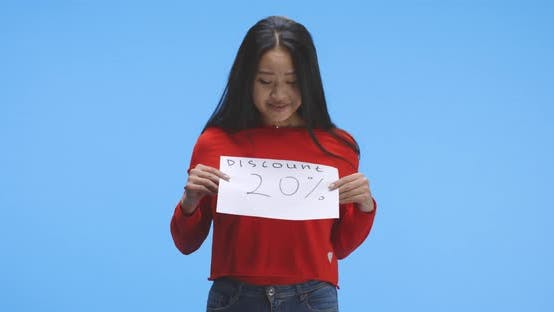 Thumbnail for Young Woman Holding Discount Sign