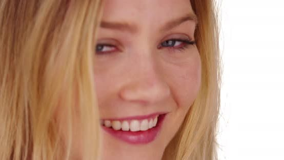Cover Image for Close up of smiling happy laughing millennial blonde woman on tropical beach