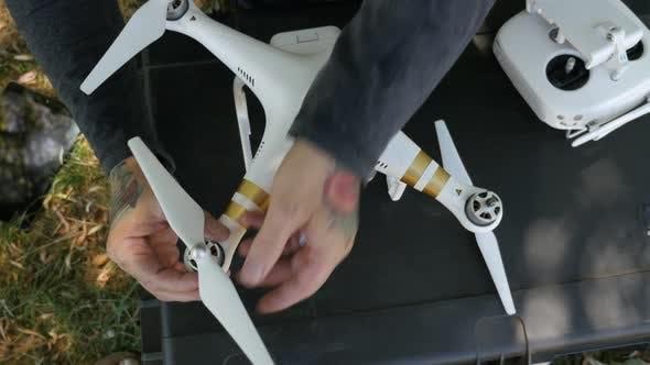 Thumbnail for Man preparing drone for flight