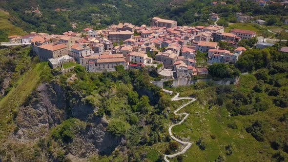 Thumbnail for Aerial View of Medieval City on Hill Overlooking the Sea Coast Village and Mountains, Tiled Roofs