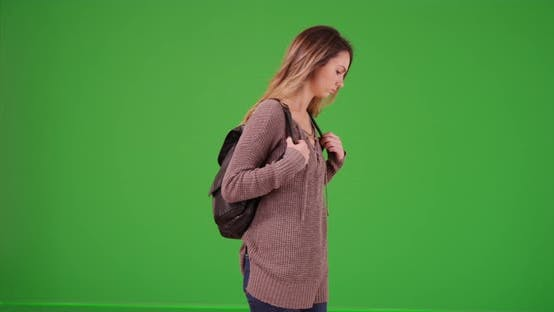 Thumbnail for Caucasian millennial girl answering text on green screen