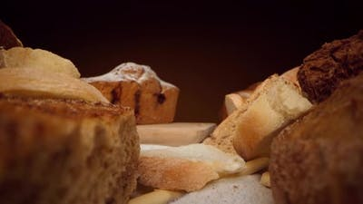 Assortment of Fresh Bread and Bakery on Table Zoom in Video