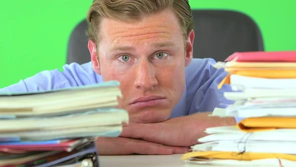 Thumbnail for businessman distressed over paperwork on greenscreen