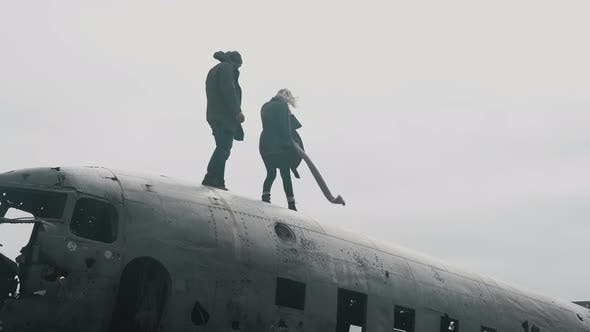 Thumbnail for Young Traveling Couple Walking on the Top of Crashed DC-3 Plane in Iceland in the Windy Overcast Day