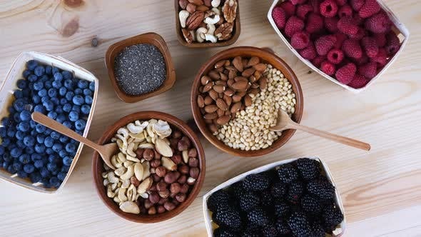 Nuts, Seeds And Berries On The Wooden Table, Superfoods