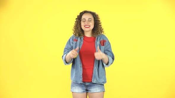 Thumbnail for Young Cheerful Woman Showing Thumbs Up, Gesture Like, Over Yellow Background
