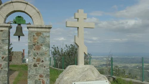 Time Lapse of Clouds Moving in Sky Over Orthodox Stone Cross Near Monastery