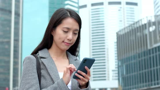 Thumbnail for Businesswoman use of smart phone in city